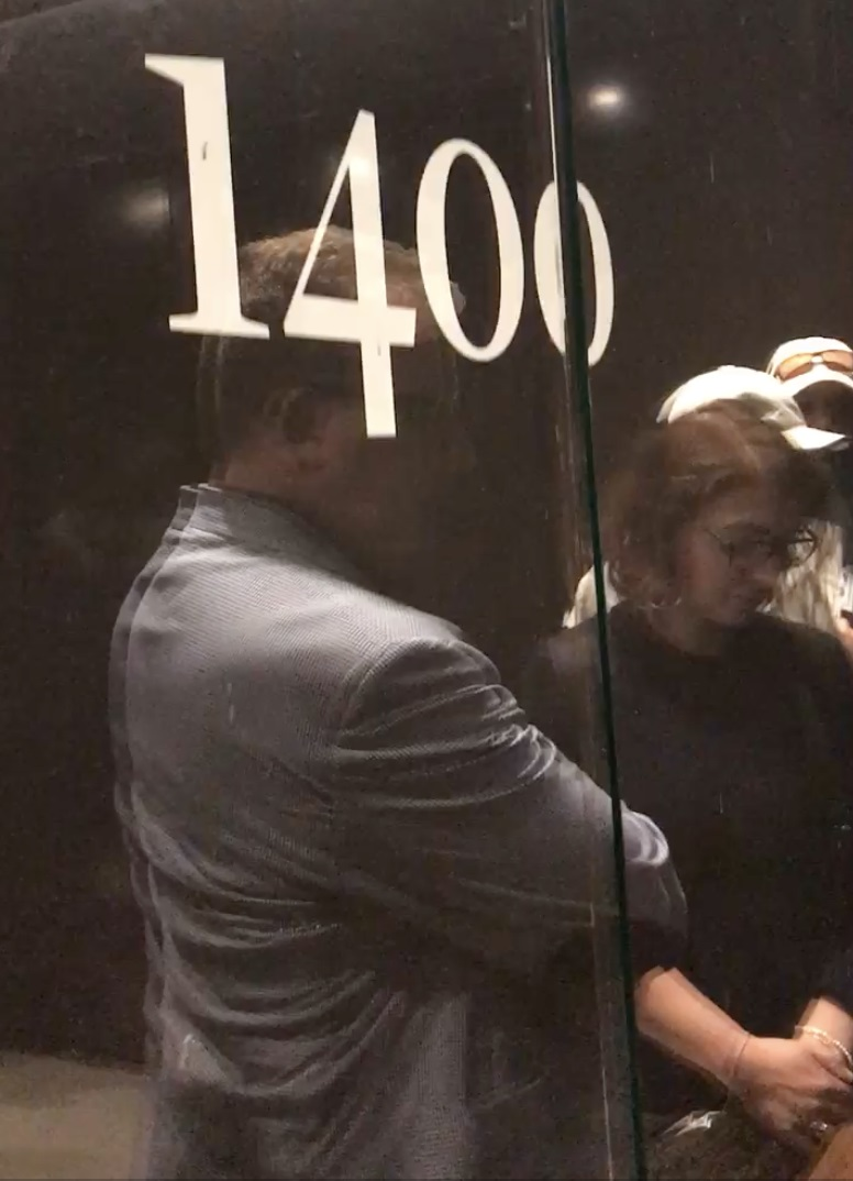 Visitors reach the beginning of the history exhibition, and are depicted as they wait to depart the elevator.