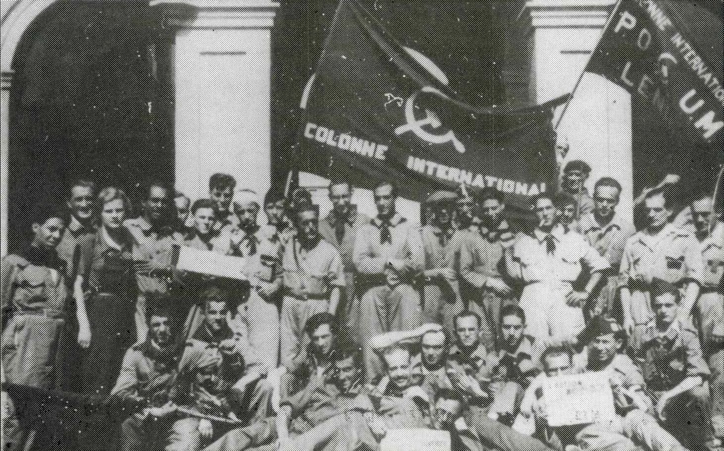"""Lenin International Column posing in the courtyard of the """"Casernes Lenin"""" (Lenin Barracks), summer 1936."""