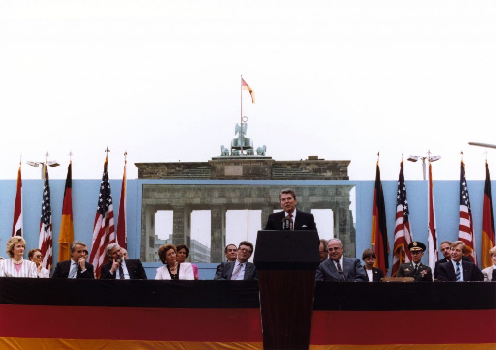 Ronald Reaga speaks at the Berlin Wall Brandenburg Gate on June 12, 198, challenging-Gorbachev to tear down the wall