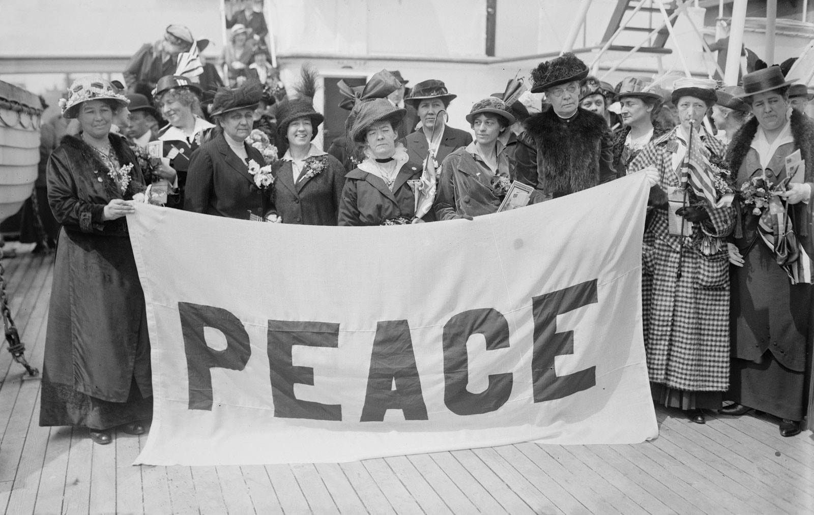 Jane Addams (second from left) and other delegates on the deck of the ship that would take them to The Hague, where the International Women's Congress (1915) was to be held. LOC (George Grantham Bain Collection (LC-DIG-ggbain-18848)